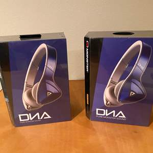 Lot # 149 - Two New in Box Monster DNA Headphones