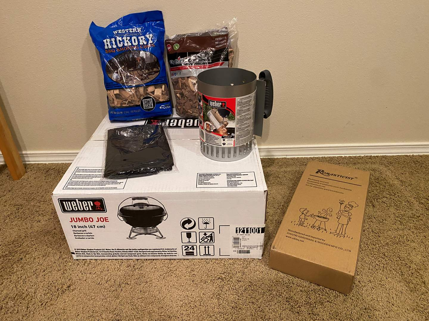 Lot # 156 - New in Box Weber Jumbo Joe Grill, New Weber Rapid Fire Starter, New Grilling Tools, Two Bags of Smoking Chips  (main image)