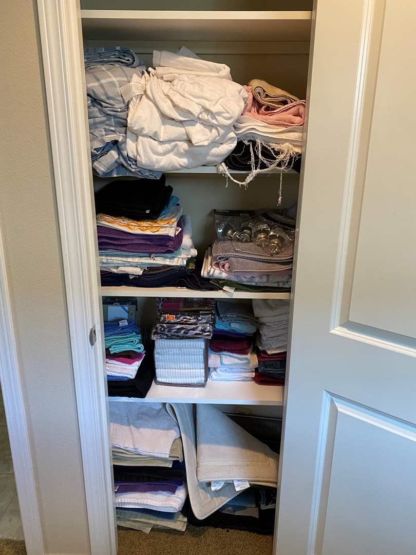 Lot # 183 - Closet Full of Linens, New Shower Curtains, Hooks & Bathmats  (main image)