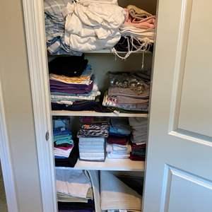 Lot # 183 - Closet Full of Linens, New Shower Curtains, Hooks & Bathmats