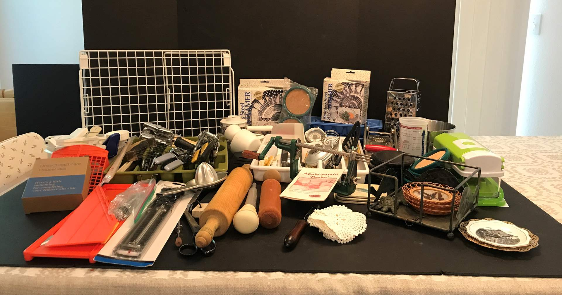 Lot # 64 - Large Lot Of Kitchen Items: Apple Peeler, Veggie Choppers, Measuring Spoons, Can Openers, Cheese Graters & More (main image)