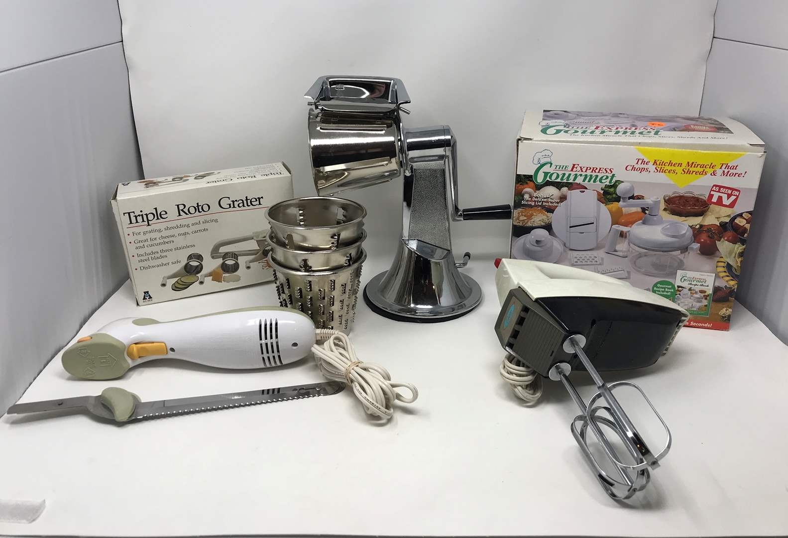 Lot # 66 - Cheese Graters Electric Beaters, Black & Decker Electric Knife & More (main image)