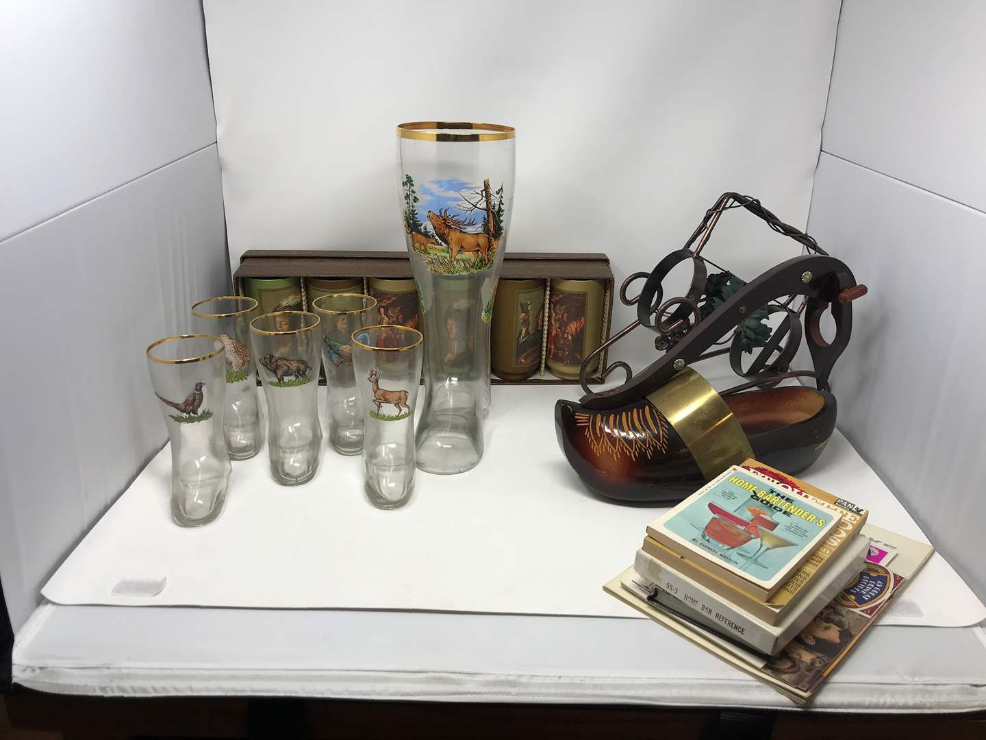Lot # 69 - Cool Boot Steins, Wins Bottle Decor & Drink Mixing Books (main image)