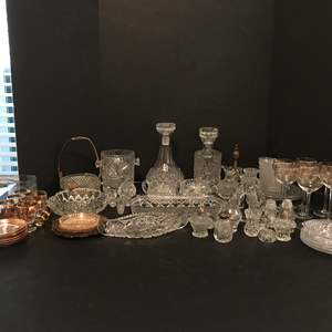 Lot # 75 - Lot Of Crystal Glass: Decanters, Stemware, Salt & Pepper Shakers, Candle Holders & More