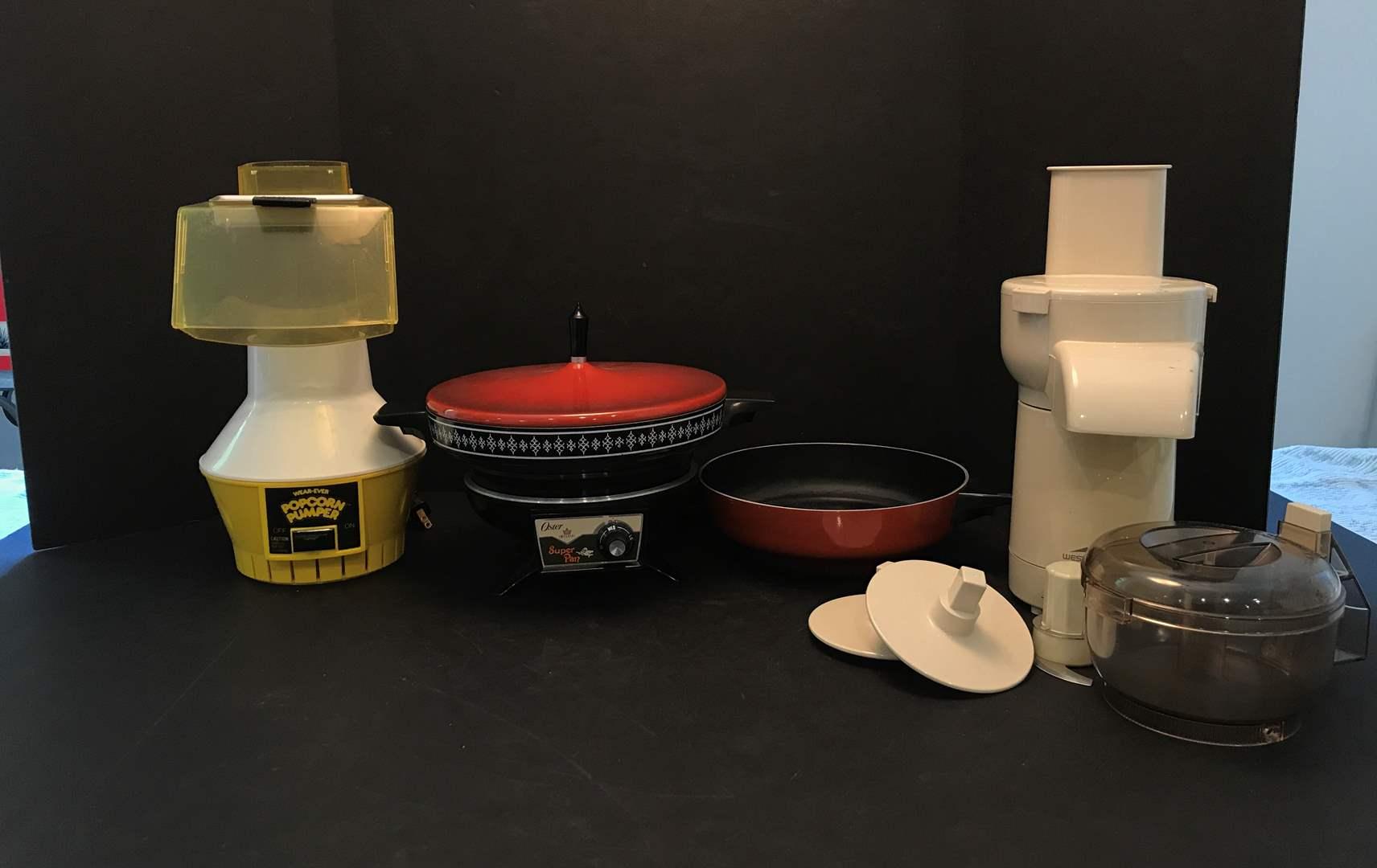 Lot # 80 - Wear Ever Popcorn Maker, Oster Super Pan, West Bend Food Processor  (main image)