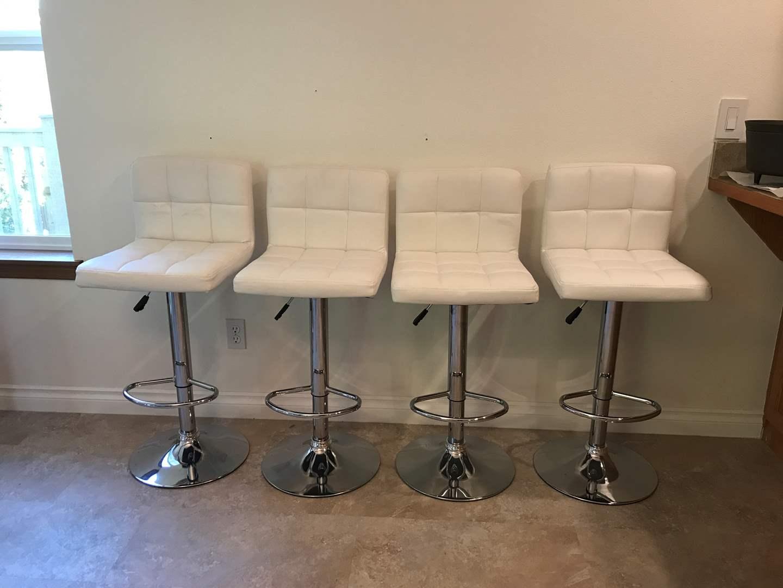 Lot # 97 - 4 Leather? Adjustable Barstools  (main image)