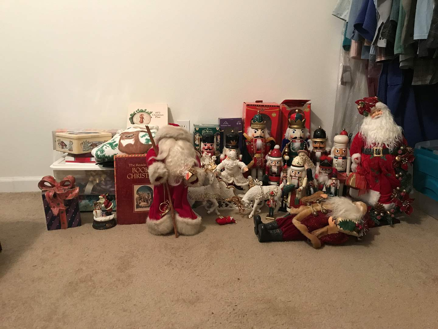 Lot # 100 - Lot Of Christmas Nutcrackers, Wrapping Paper, Santa's & More (main image)