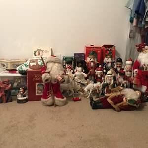 Lot # 100 - Lot Of Christmas Nutcrackers, Wrapping Paper, Santa's & More