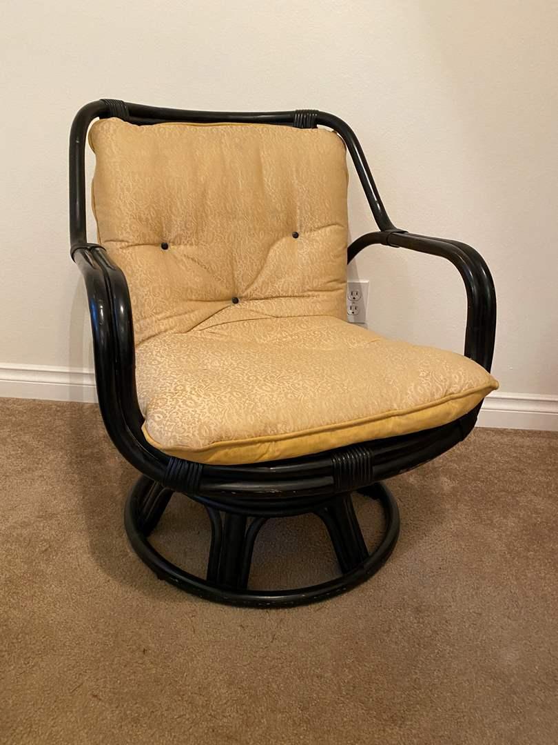"Lot # 10 - ""Ming"" Rattan Swiveling Rocking Armchair (main image)"