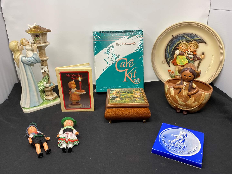 Lot # 29 - Hummel Music Box, Collector Plate, Hummel Care Kit, Goebel (Byi 57), Vintage Flowerpot & More (main image)