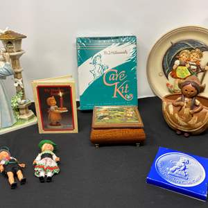 Lot # 29 - Hummel Music Box, Collector Plate, Hummel Care Kit, Goebel (Byi 57), Vintage Flowerpot & More