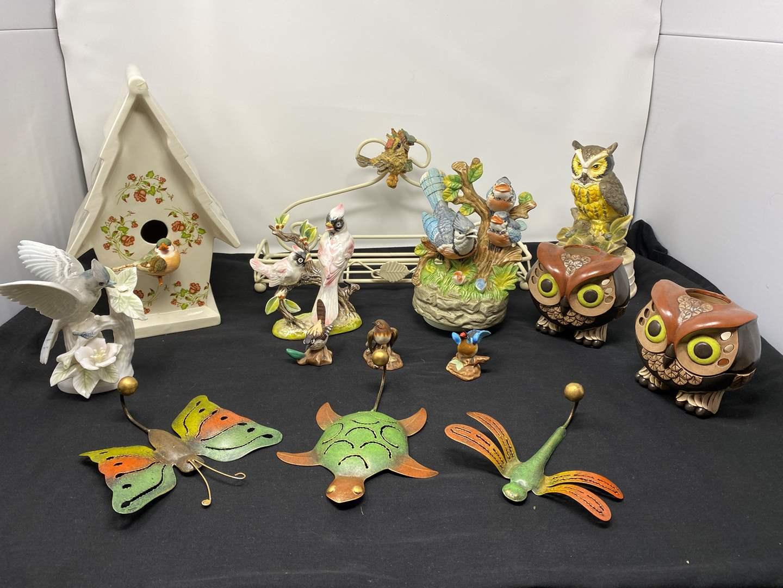 Lot # 33 - Collection of Ceramic & Porcelain Birds, Metal Rack, Ceramic Birdhouse, Owl Candle Holder, & Musical Birds (main image)