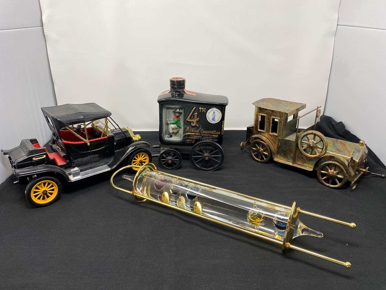 Lot # 49 - Glass Thermometer Float, Metal Car Music Box, Full Vintage Jim Beam Decanter, Plastic Batt. Operated Old Timer Car (main image)