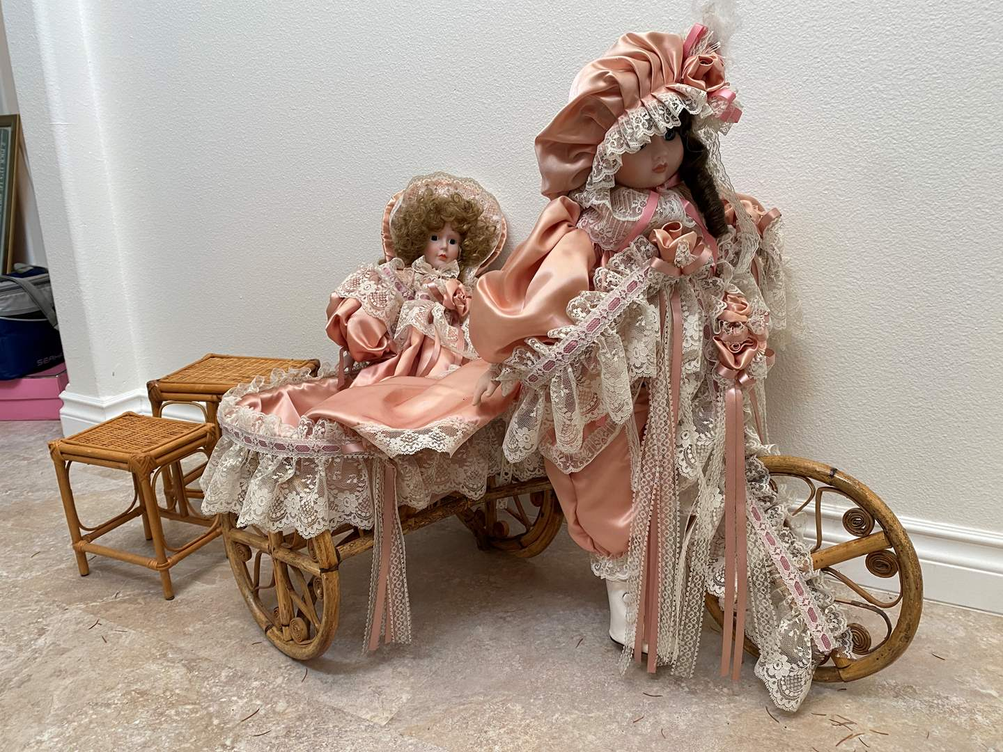 Lot # 123 - Rattan Tricycle w/ Two Platinum Collection Victorian Series-Porcelain Dolls, Small Rattan Stools (main image)