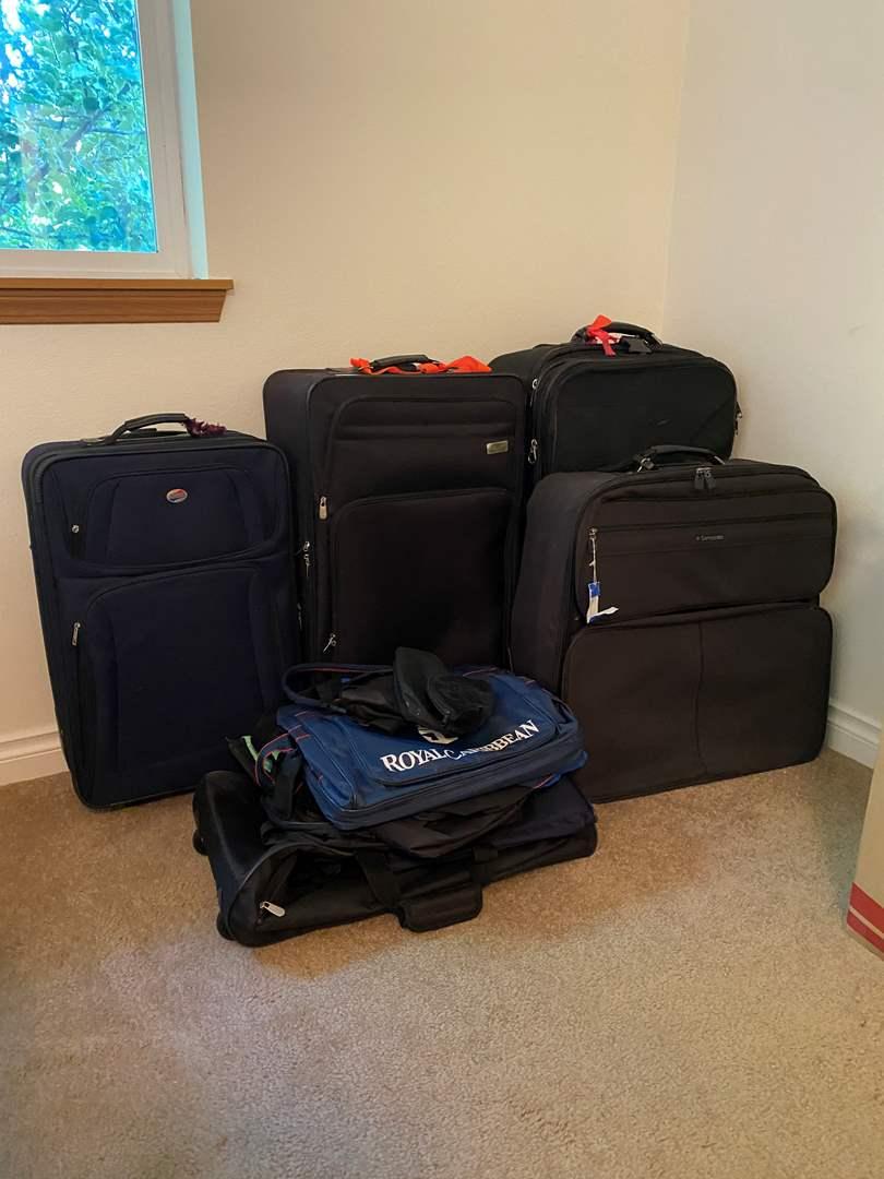 Lot # 131 - Suitcases & Duffel Bags (main image)