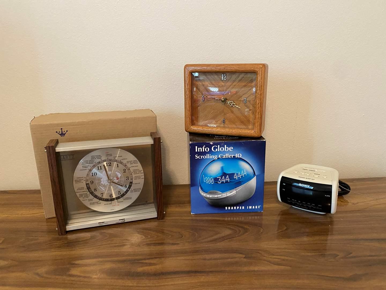Lot # 162 - Lord King Quartz World Clock, Wood Clock, Sony Alarm Clock, New Info Globe Caller ID (main image)