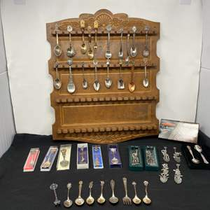 Lot # 121 - Spoon Rack w/ Collector Spoons ( 9 Sterling Silver - 95 Grams)