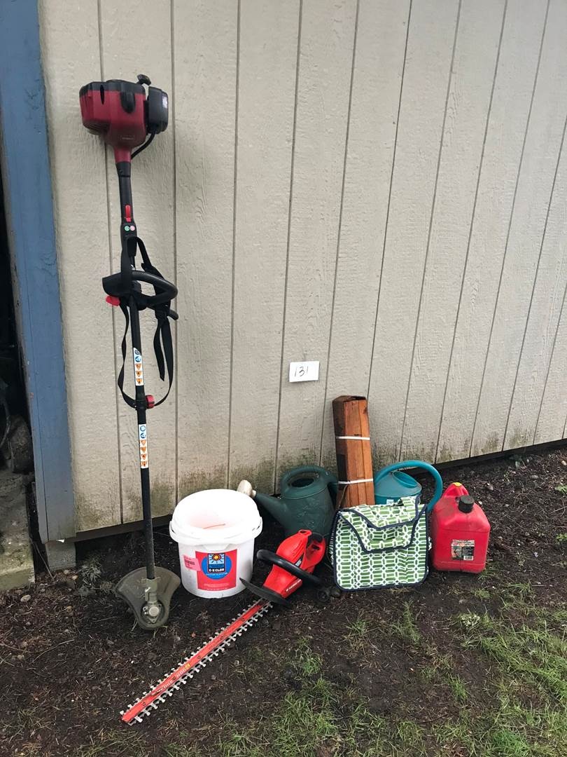 Lot # 131 -  Toro 2 Stroke Weed Trimmer, Extra Line, Black & Decker Hedge Trimmers, Tool Caddie, 2 Watering Cans, Gas Can. (main image)