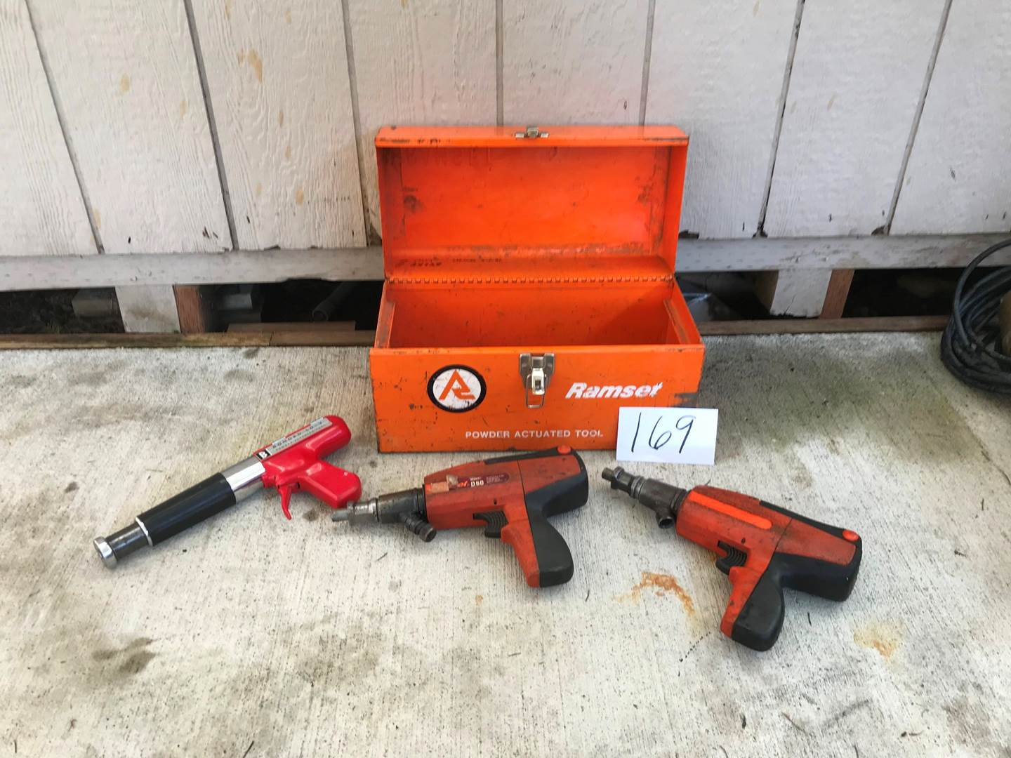 Lot # 169 - 2 Ramset Powder Actuated Tools # D60, Bonded Lo-V Powder Actuated Tool 2/ Metal Ramset Tool Box. (main image)