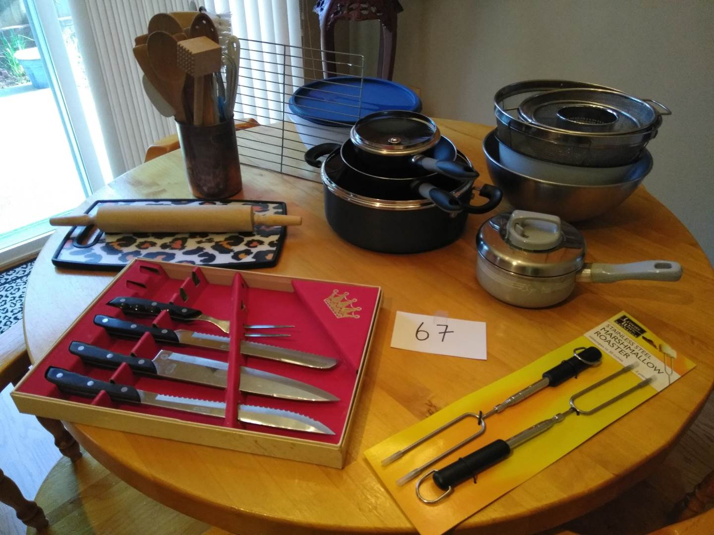 Lot # 67 - Pots & Pans, cutting board, rolling pin, copper tin w/wooden utensils, plastic bowl set, more (main image)