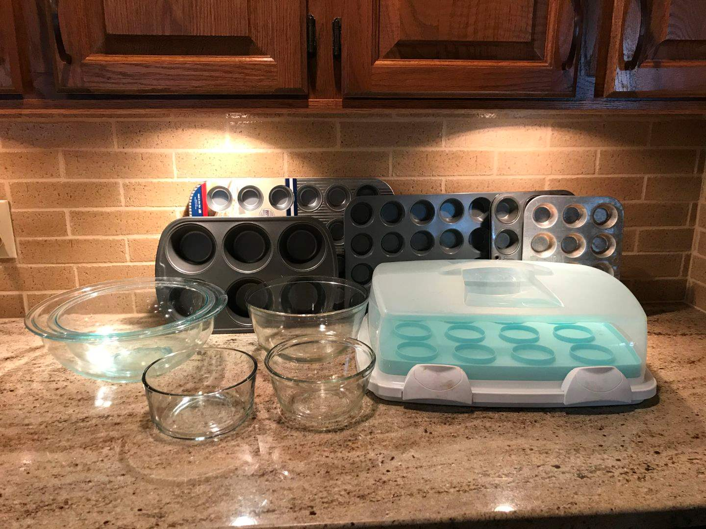 Lot # 52 - Pyrex Mixing Bowls of Various Sizes, 2 Anchor Hocking Bowls, Mini Muffin Tins & Muffin Carrying Case (main image)