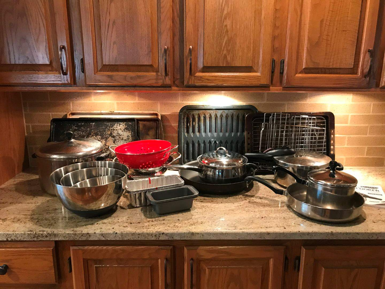 Lot # 55 - Pots & Pans, Baking Racks, Mixing Bowls, Pressure Cooker & Small Bread Pans (main image)