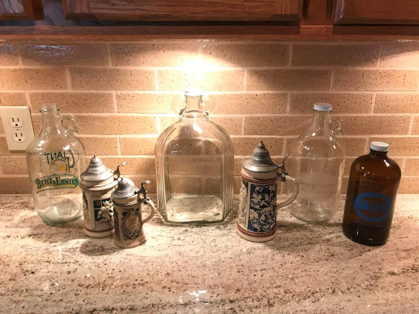 Lot # 67 - Beer Steins & Glass Jugs (main image)