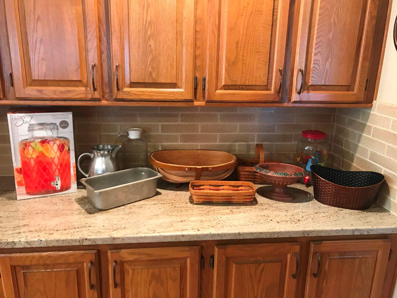 Lot # 71 - Drink Dispensers, Wood Baskets, Cast Iron Planter & More.. (main image)