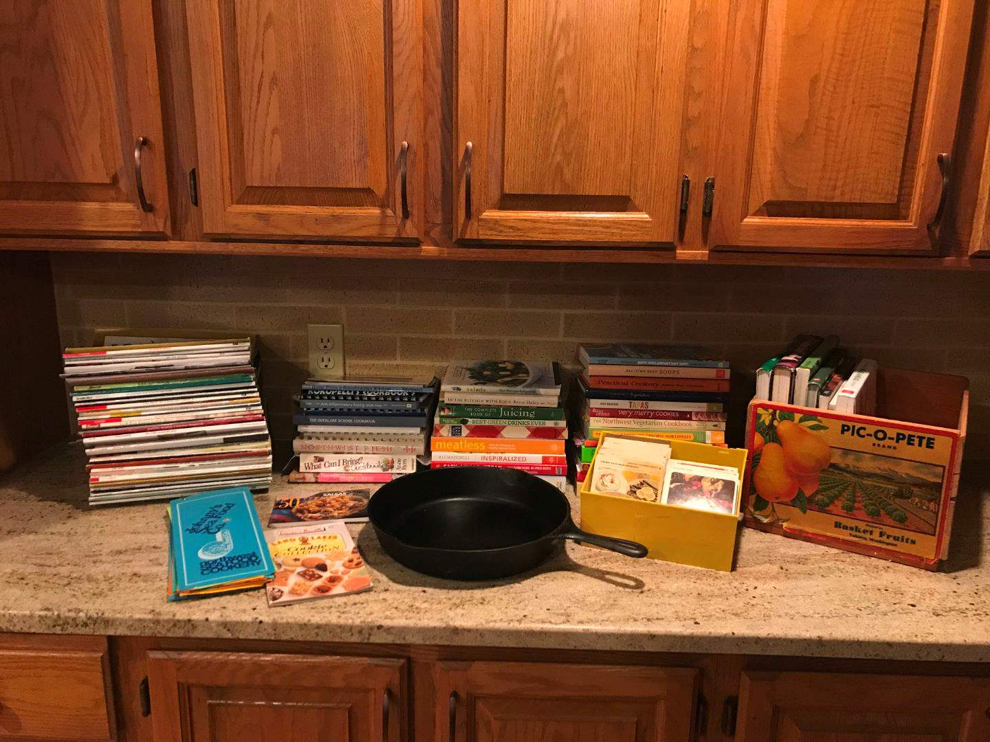 Lot # 72 - Cast Iron #10 Skillet w/ Small Collection of Cook Books (main image)