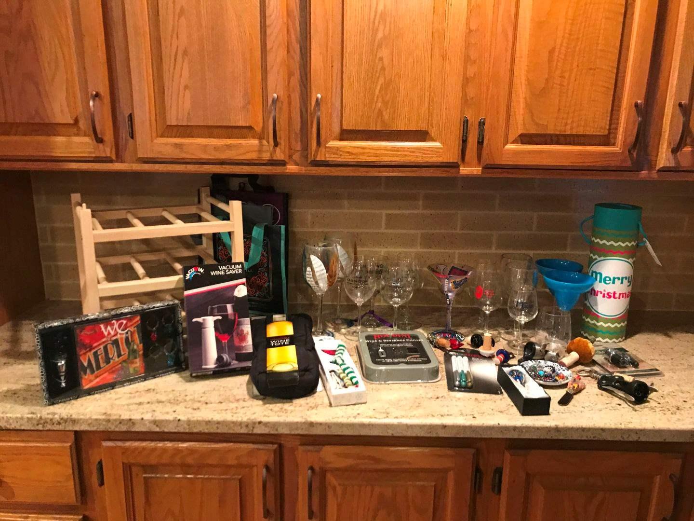 Lot # 73 - Wine Rack, Wine Glasses, Wine Corks & Some Plastic Wine Glasses (main image)