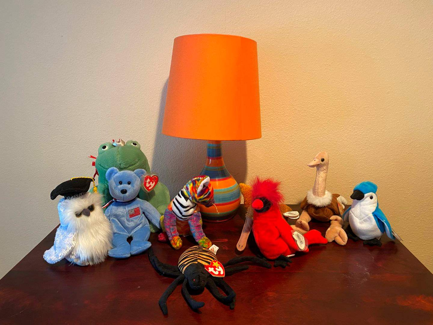 Lot # 122 - Small Colorful Lamp w/Small Collection of Beanie Babies (main image)