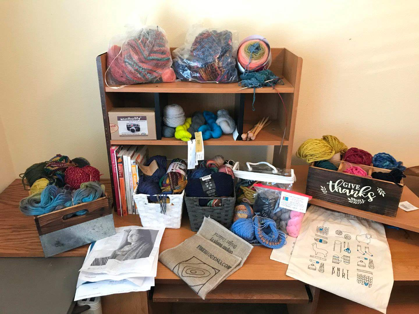 Lot # 107 - Selection of Yarns of Various Colors, Knitting Patterns & Books (main image)