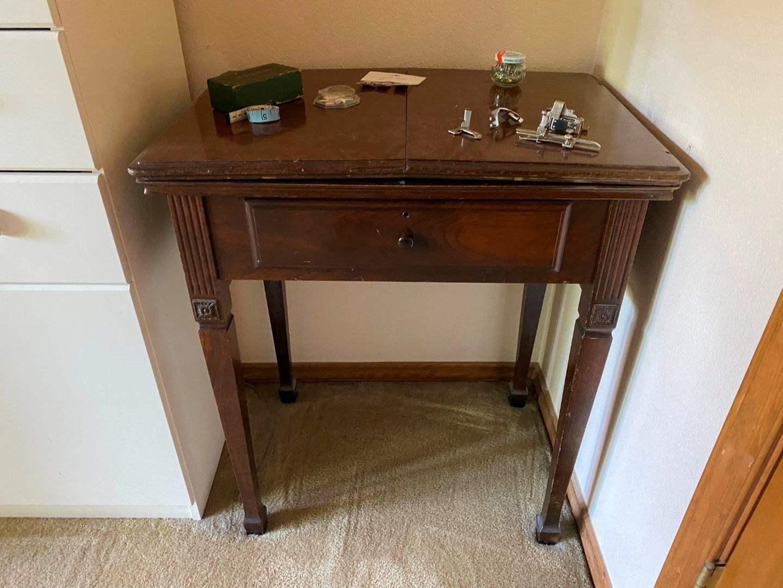 Lot # 180 - Vintage/Antique Sewing Machine Cabinet w/Implements  (main image)