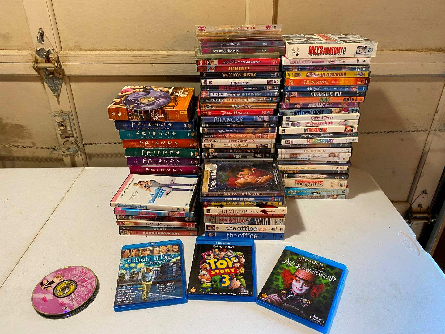 Lot # 218 - DVD's: Friends, Lion King, Hairspray, The Office, The Zoo Keepers Wife, Goonies & More - (See Pictures) (main image)