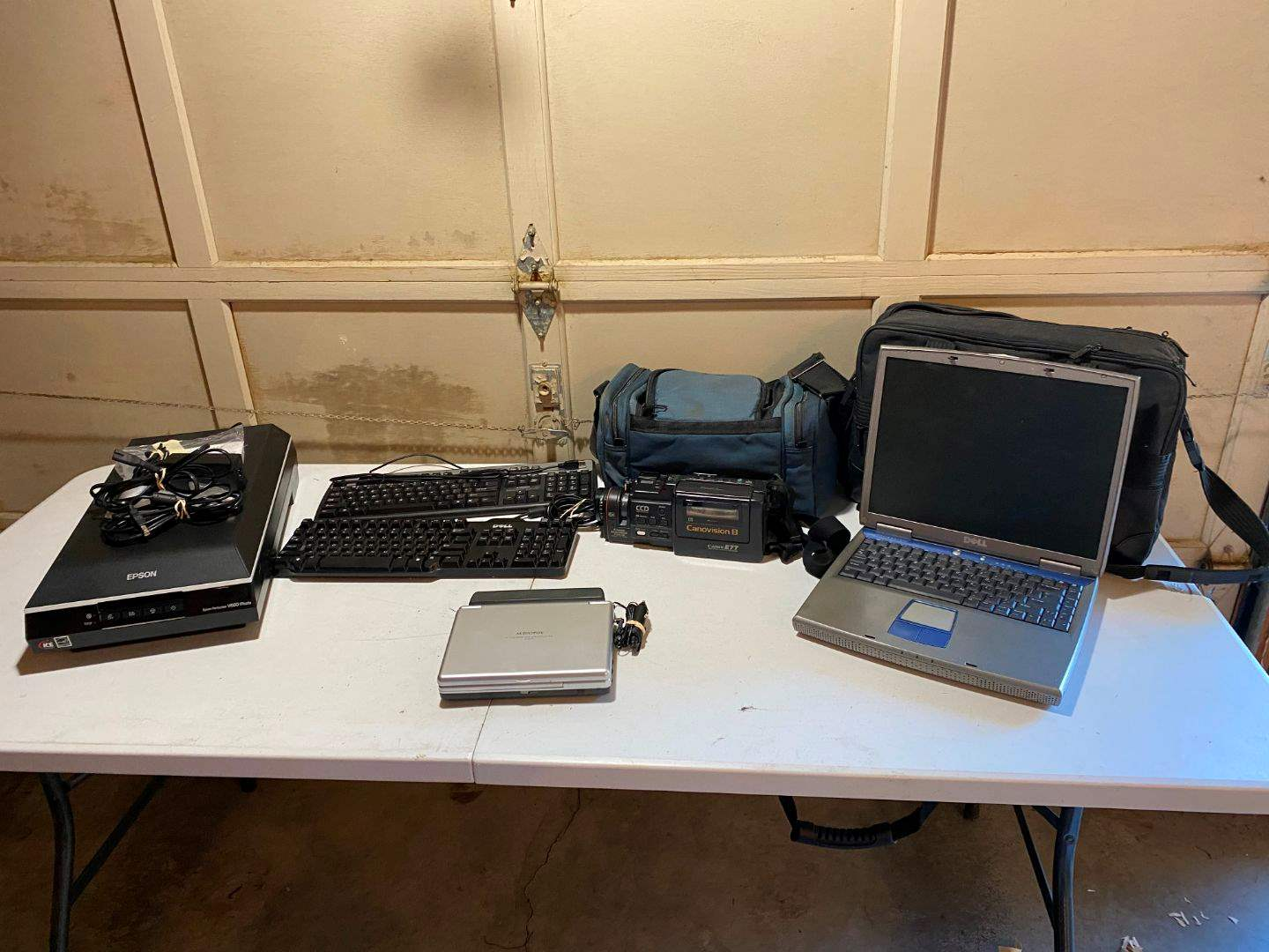 Lot # 222 - Epson V600 Photo Scanner, Key Boards, Dell Laptop, Canon Camcorder, Audiovox Portable DVD Player (main image)