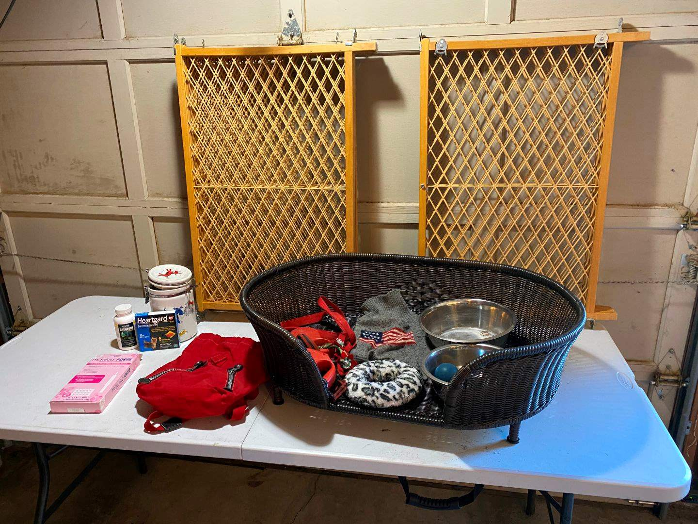 Lot # 223 - Dog Lot: Wicker Dog Bed, Baby Gates, Leashes, Food Dishes (main image)