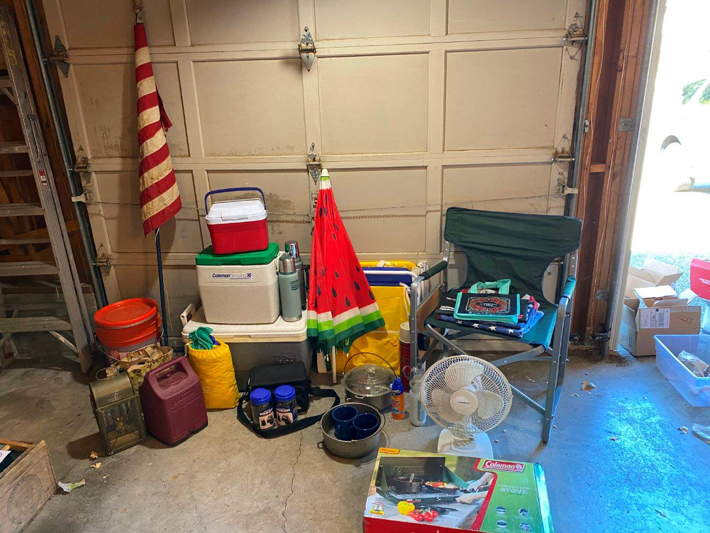 Lot # 236 - Camping: Coleman Stove, Coolers, Folding Chairs, Coleman Lantern, Cookware, Flags & More. (main image)