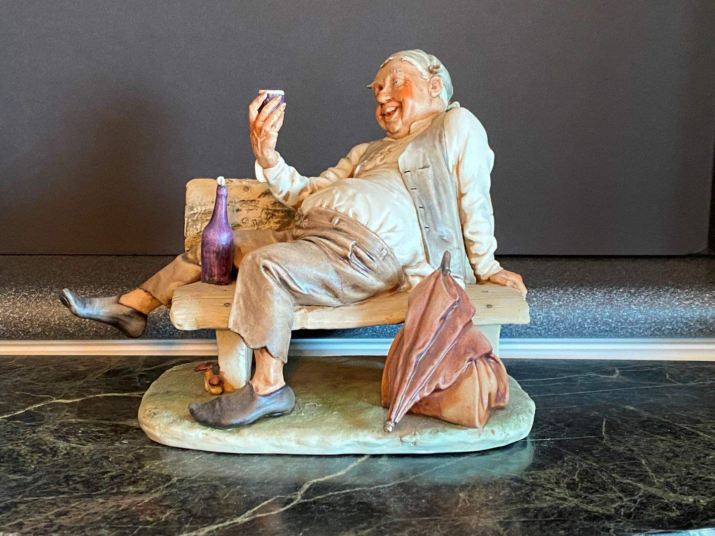 Lot # 59 - Man Drinking on Bench Capodimonte Figurine  (main image)