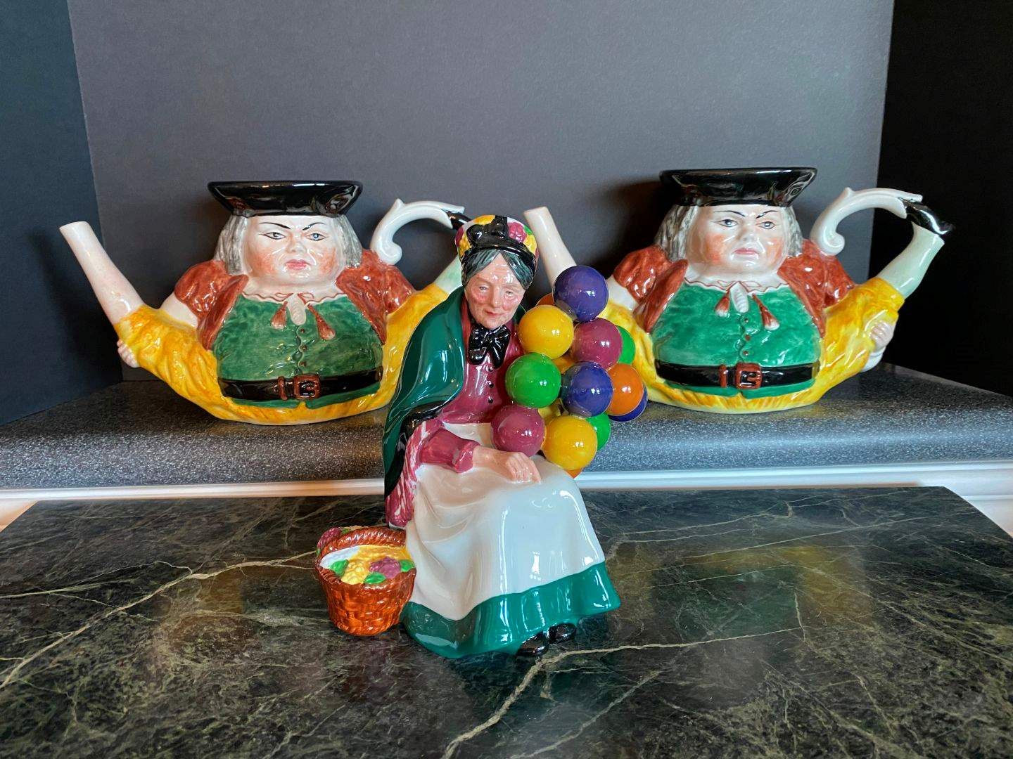 "Lot # 80 - Two Toby Style Ceramic Tea Pots Made in Italy #3059, Royal Doulton ""The Old Balloon Seller"" Figurine (main image)"