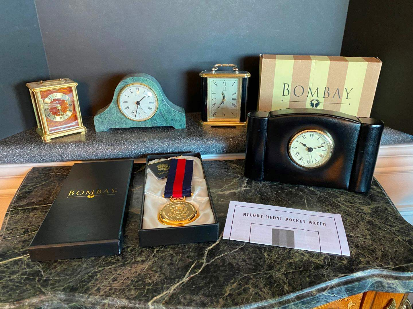 Lot # 137 - Bombay Melody Medal Pocket Watch, Small Bombay Clock, Howard Miller Clock, Staiger Marble Clock & More.. (main image)
