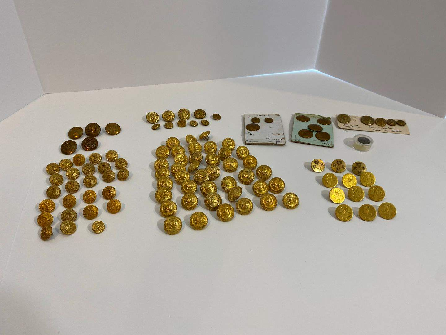 Lot # 211 - Nice Selection of Antique/Vintage Brass Buttons: Army, Fisheries, RRH, Royal Cruising Club & More.. (main image)