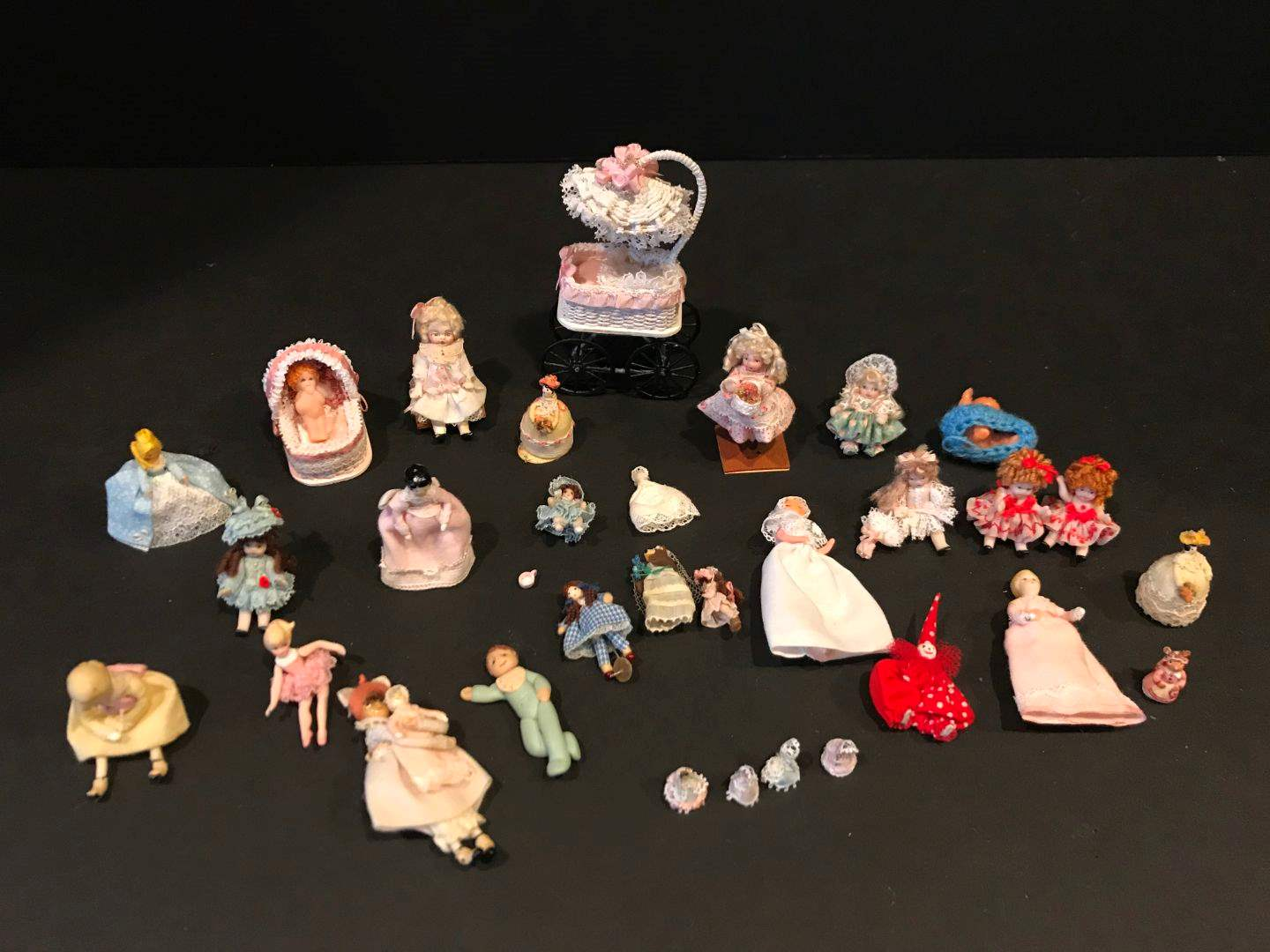 Lot # 166 - Various Sizes of Miniatures Some Porcelain & Miniature Baby Carriage  (main image)