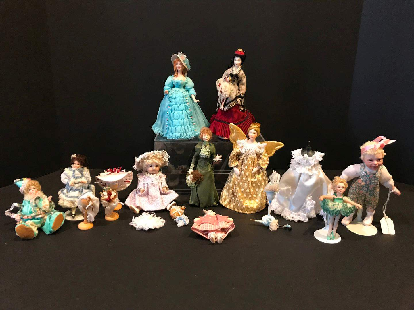 Lot # 168 - Porcelain Doll, One Wood Doll & Accessories  (main image)