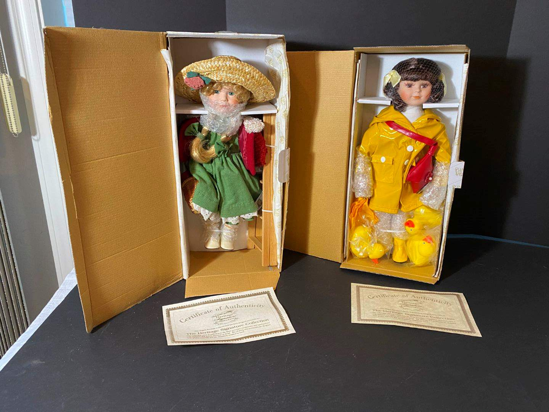 "Lot # 242 - Two Heritage Signature Collection Porcelain Dolls ""Apple Annie"" & ""April Showers"" (main image)"