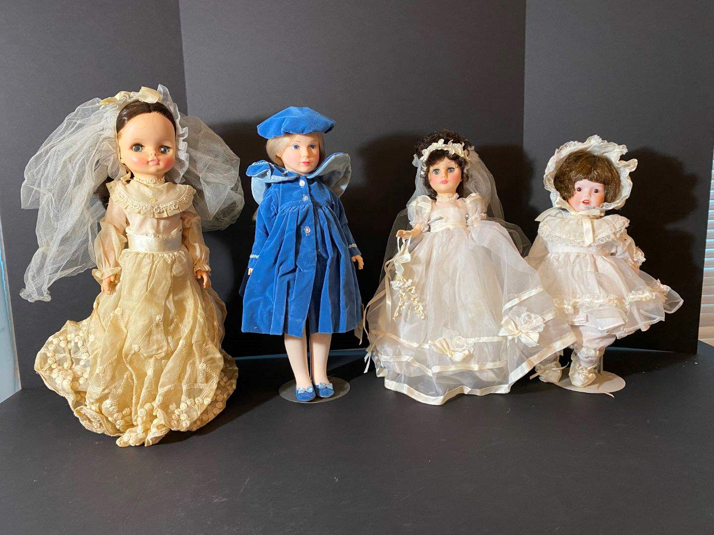 Lot # 245 - One Porcelain Doll & Three Effanbee Dolls  (main image)