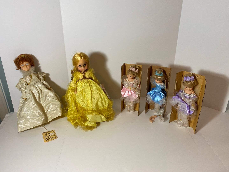 Lot # 256 - Three Small Porcelain Dolls, Two Vintage Plastic Dolls  (main image)