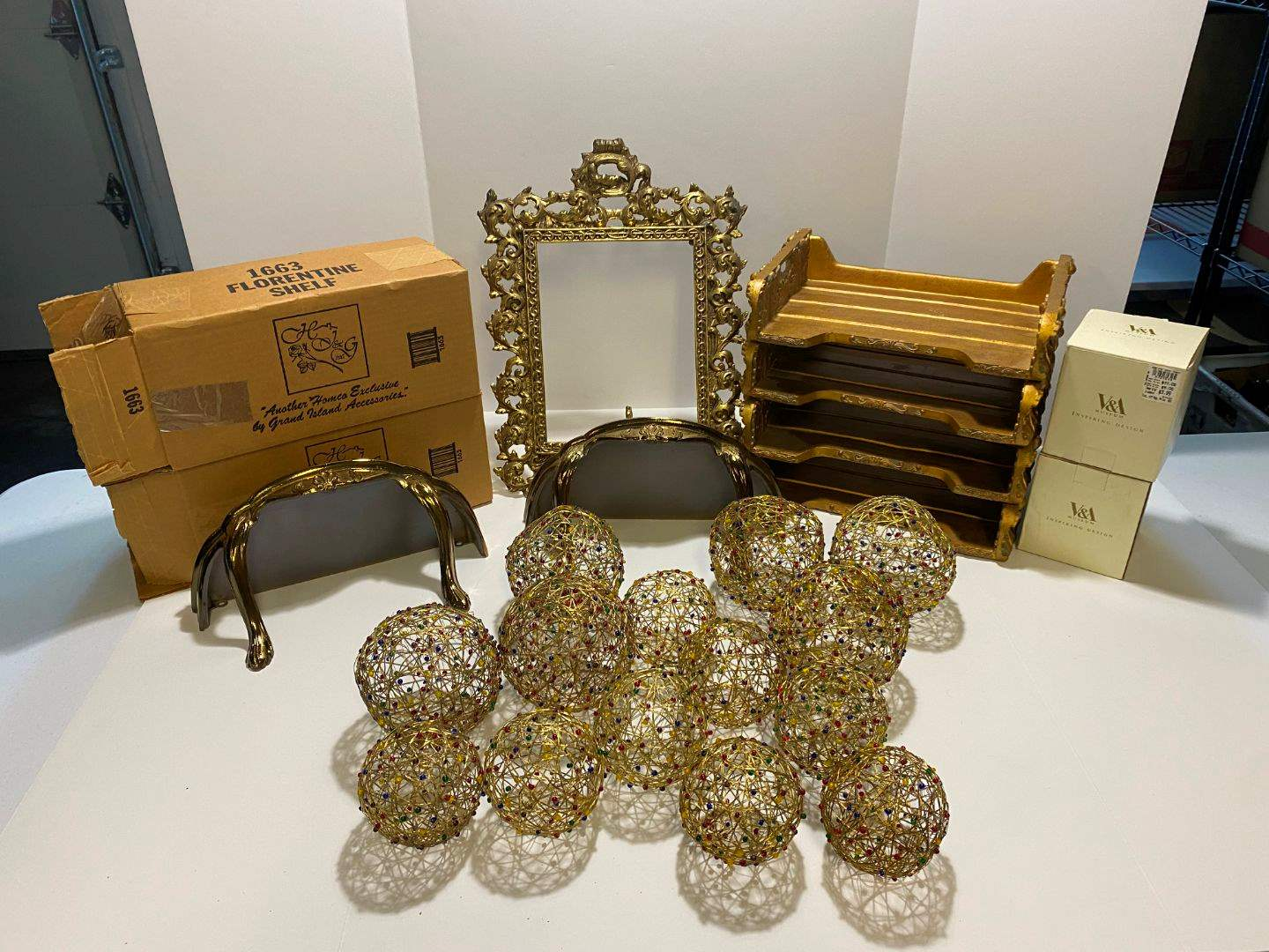 Lot # 367 - Decorative Balls, Heavy Brass Picture Frame, 2 New Florentine Shelves & 4 Slot Resin Office Organizer (main image)