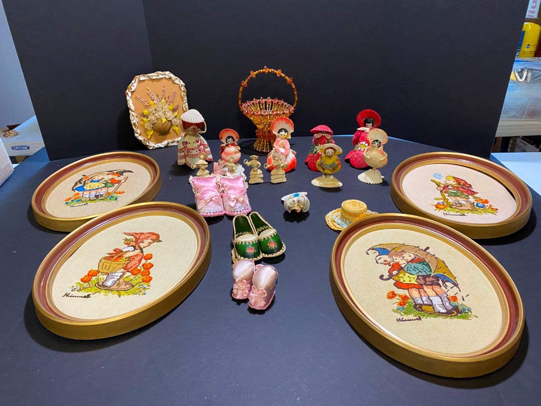 Lot # 397 - Hummel Cross Stitch Wall Art, Handmade Shell Dolls & Wall Art  (main image)