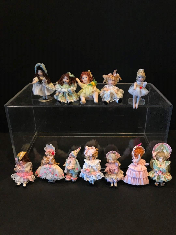 "Lot # 162 - 12 Porcelain Miniature Dolls ""Angel Children"" by Ethel Hicks (main image)"
