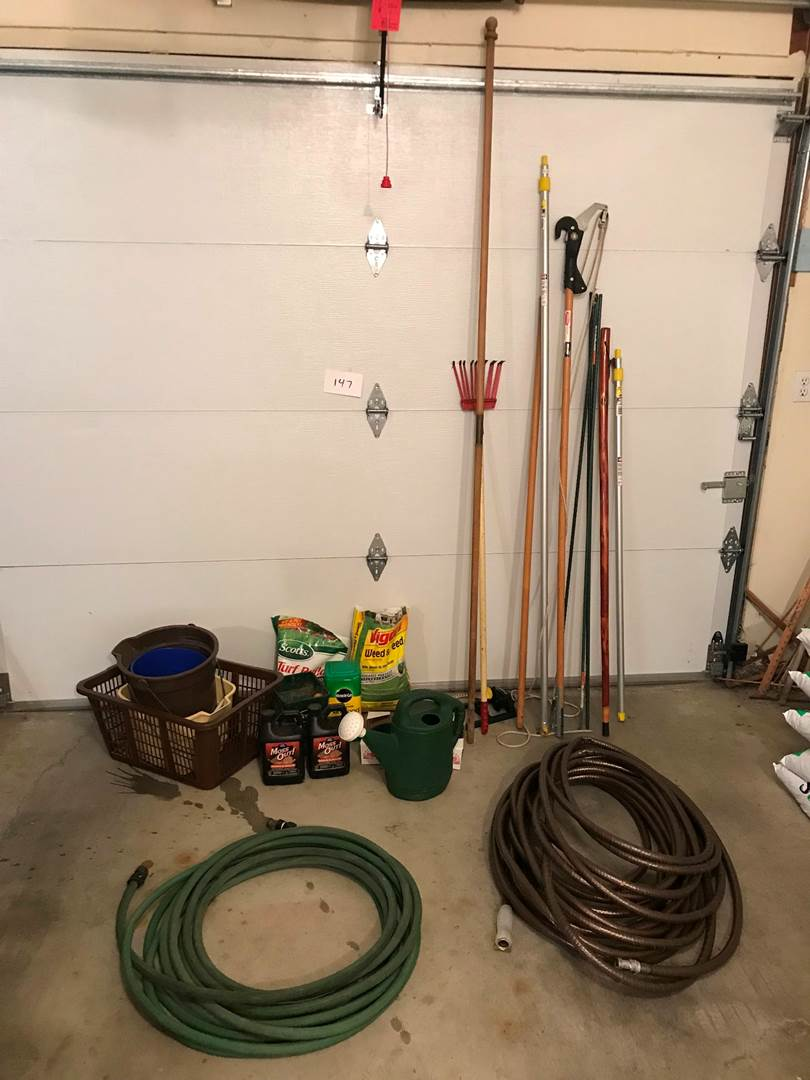 Lot # 147 - Lawn fertilizers, moss out, branch trimmer, hoses, hiking stick and more (main image)